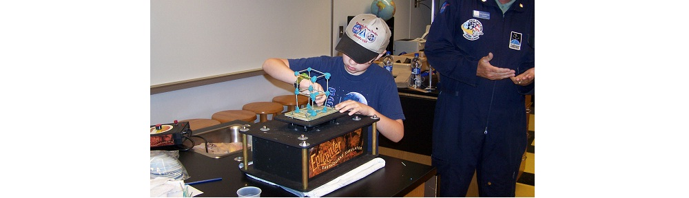 Student using Earthquake machine.