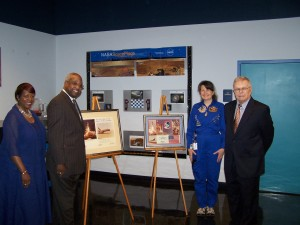Challenger Learning Center Director Dr. Carolyn Donelan (l) accepts space memorabilia from former USC President James. B. Holderman.  Holderman was given the pieces by NASA Astronauts John W. Young and Robert L. Crippen who received honorary degrees during USC Commencement May 16, 1981.